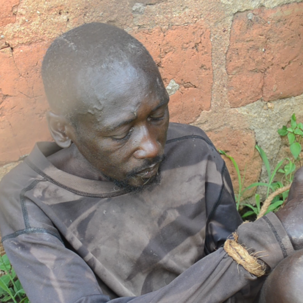 Brutally tortured man tied with ropes dumped in Mukono town by unknown people